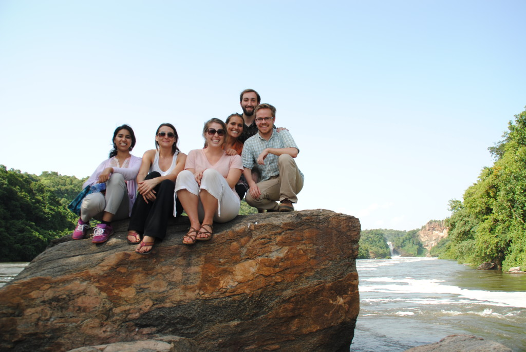 Ethan Rank (top) and Robert Francis (far right) with AidData fellows at Murchison Falls. Each member of the group worked with an international development organization in Uganda for the summer.